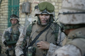 Capt. Doug Zembiec, the commanding officer of Company E, 2nd Battalion, 1st Marine Regiment, 1st Marine Division, gives orders to his men over a radio prior to leaving their secured compound for a short patrol in Fallujah, Iraq April 8, 2004.The company entered Fallujah April 6 to begin the effort of destroying enemy holded up in the city. (Official USMC photo by Sgt. Jose E. Guillen)